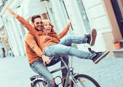 couple-riding-bike